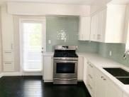 The Monroe_Suite 1_Kitchen_Stove & Patio Door